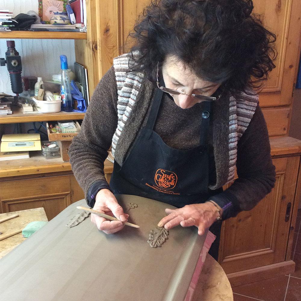 Stufe a ole fatte a mano, artigianato italiano stufe made in Italy